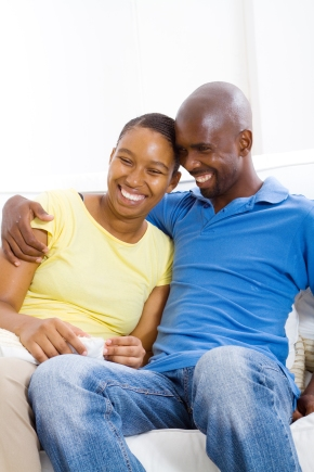 young happy african american couple relaxing at home